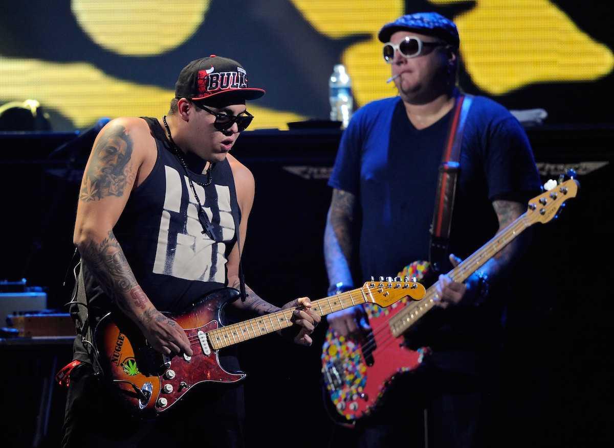 LAS VEGAS, NV - SEPTEMBER 24: Singer/guitarist Rome Ramirez (L) and bassist Eric Wilson of the band Sublime with Rome perform at the iHeartRadio Music Festival at the MGM Grand Garden Arena September 24, 2011 in Las Vegas, Nevada. (Photo by Ethan Miller/Getty Images for Clear Channel)